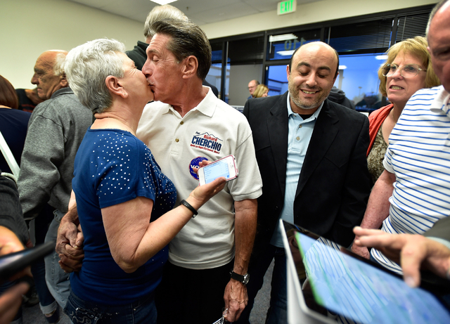 Richard Cherchio, and his wife, Gloria, surrounded by supporters, embrace with a kiss during his election night party at his North Las Vegas campaign headquarters on Tuesday, April 7, 2015. Cherch ...