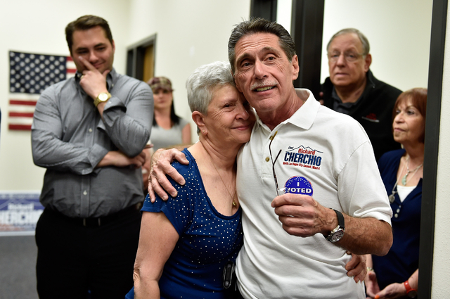 Richard Cherchio, and his wife, Gloria, surrounded by supporters, embrace during his election night party at his North Las Vegas campaign headquarters on Tuesday, April 7, 2015. Cherchio, who lost ...
