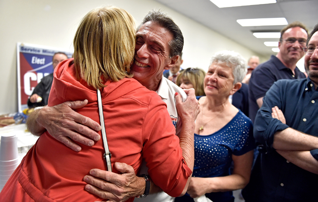 Richard Cherchio, center, receives a hug from a supporter as his wife, Gloria, looks on during his election night party at his North Las Vegas campaign headquarters on Tuesday, April 7, 2015. Cher ...