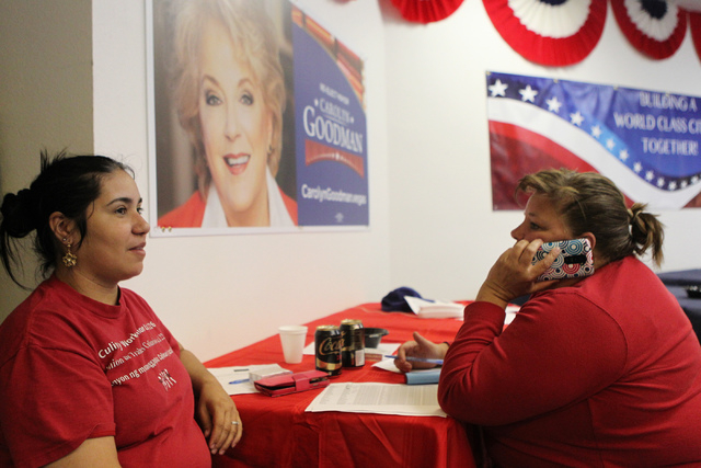 Volunteer organizers Dallamy Santos, left, with Glenna Bolster, make last minute phone calls to voters for the re-election of Mayor Carolyn Goodman at her campaign headquarters in Las Vegas during ...