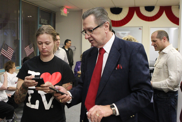 Volunteer coordinator Anna Veverka, left, with Tom Letizia, campaign manager for Mayor Carolyn Goodman, look for election poll numbers during Goodman's re-election night party at her campaign head ...