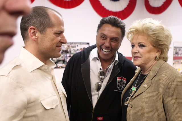 Ross Goodman, from left, with friend Tommy White, and mother and Mayor Carolyn Goodman, speaks to each other at her re-election night party at her campaign headquarters in Las Vegas Tuesday, April ...