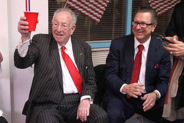 Former Las Vegas Mayor Oscar Goodman, left, with Tom Letizia, campaign manager for Mayor Carolyn Goodman, share a moment at Carolyn Goodman's re-election night party at her campaign headquarters i ...