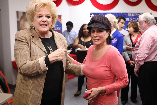 Mayor Carolyn Goodman, left, with Loretta St. John, share a moment at Goodman's re-election night party at her campaign headquarters in Las Vegas Tuesday, April 7, 2015. (Erik Verduzco/Las Vegas R ...