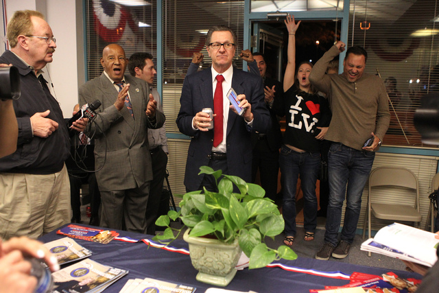 Tom Letizia, center, makes an early announcement of the election poll numbers during Mayor Carolyn Goodman's re-election night party at her campaign headquarters in Las Vegas Tuesday, April 7, 201 ...