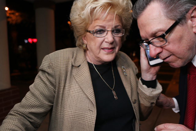 Mayor Carolyn Goodman, left, with her campaign manager Tom Letizia listen to a call with the final election poll results during Goodman's re-election night party at her campaign headquarters in La ...