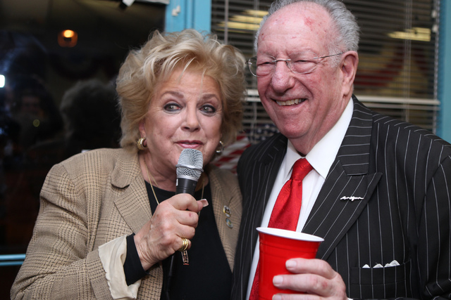 Mayor Carolyn Goodman, left, posses for photos with her husband Oscar after giving a victory speech for her supporters at her re-election night party at her campaign headquarters in Las Vegas Tues ...