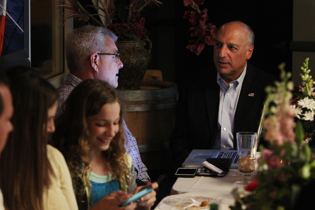Las Vegas City Councilman Stavros Anthony, right, talks with a co-campaign manager Steve Forsythe during an election night party at Mykonos Greek restaurant Tuesday, April 7, 2015. (Sam Morris/Las ...