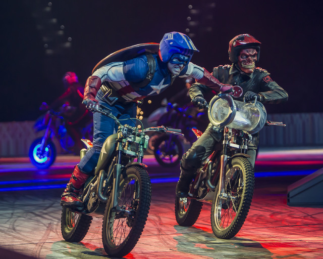 "Drivers portraying Captain America, left, and the Red Skull perform a motorcycle stunt in ""Marvel Universe Live."" (Special to View)"
