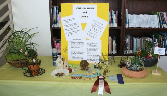 A fairy garden display is shown at the 2014 Flower Show hosted by the Sunset Garden Club. This year's event is planned from noon to 4 p.m. April 11 at the Paseo Verde Library, 280 S. Green Valley  ...