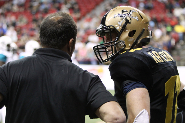 Las Vegas Outlaws quarterback J.J. Raternick talks with coach Aaron Garcia during their Arena Football League game against the Arizona Rattlers Saturday, April 4, 2014, at the Thomas & Mack Center ...