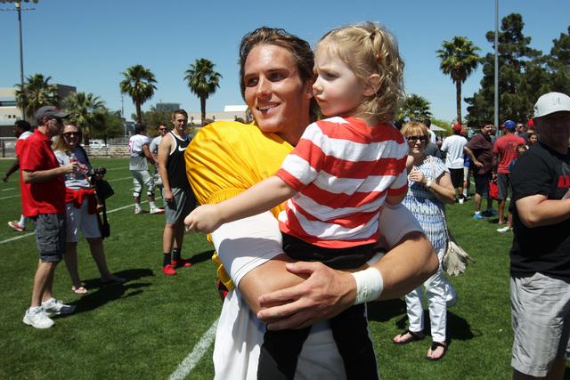 "Quarterback Blake Decker holds his niece and ""biggest fan"" Eliza Banks after UNLV football's spring scrimmage Saturday, April 18, 2015. (Sam Morris/Las Vegas Review-Journal) Follow Sam M ..."