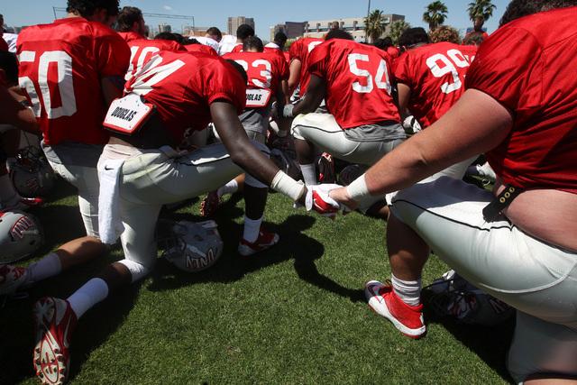 Players say a prayer after UNLV football's spring scrimmage Saturday, April 18, 2015. (Sam Morris/Las Vegas Review-Journal) Follow Sam Morris on Twitter @sammorrisRJ