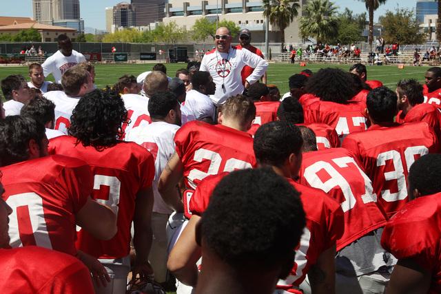 Head coach Tony Sanchez talks to his players after UNLV football's spring scrimmage Saturday, April 18, 2015. (Sam Morris/Las Vegas Review-Journal) Follow Sam Morris on Twitter @sammorrisRJ