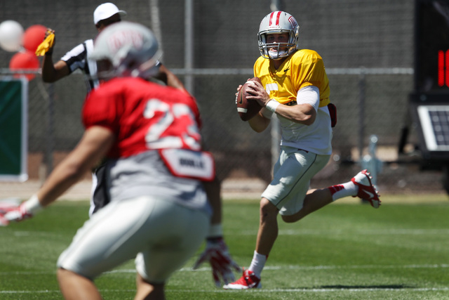 Quarterback Blake Decker looks for a receiver during UNLV football's spring scrimmage Saturday, April 18, 2015. (Sam Morris/Las Vegas Review-Journal) Follow Sam Morris on Twitter @sammorrisRJ