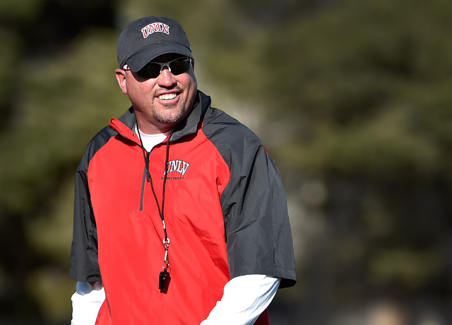 UNLV football head coach Tony Sanchez watches his team run drills during the first day of spring practice at Rebel Park at UNLV on Monday, March 16, 2015, in Las Vegas. Sanchez is making his colle ...