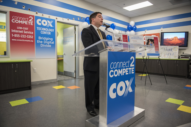 Commissioner Michael O'Rielly of the Federal Communications Commission (FCC) speaks to the news media during an announcement for the Connect2Compete program at a ribbon cutting ceremony for the Co ...