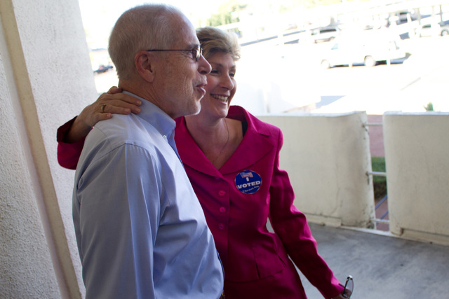 Gary Gray is pictured with his wife, Clark County Commissioner Chris Giunchigliani, at a city polling station at the Griffith United Methodist Church in Las Vegas, Tuesday, June 7, 2011, during Gi ...