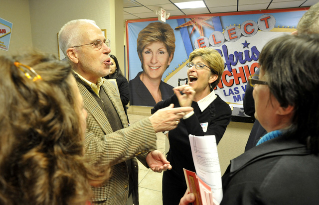 Gary Gray, left, jokes with his wife, Clark County Commissioner Chris Giunchigliani, and campaign volunteers at Giunchigliani's campaign headquarters in Las Vegas, Saturday, Feb. 26, 2011, when sh ...