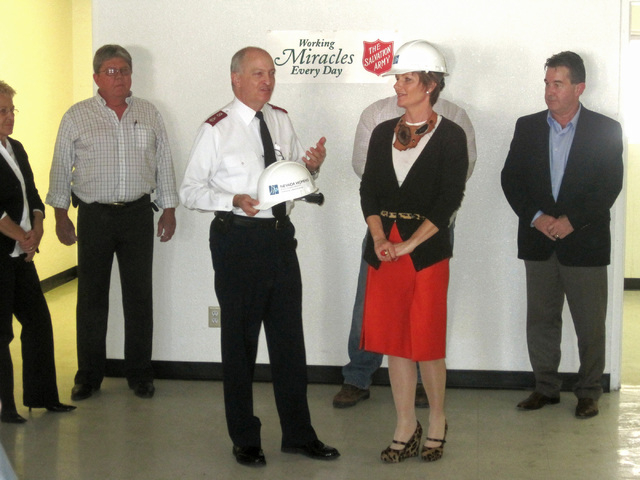 Major Robert Lloyd, center, the Clark County coordinator for the Salvation Army of Southern Nevada, speaks with Susie Lee, president of Nevada Women's Philanthropy, during a emergency shelter expa ...