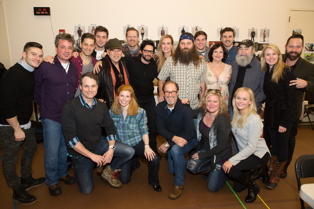 "The cast of the ""Duck Commander Musical""  poses for a photo with Korie and Willie Robertson, authors of the book ""The Duck Commander Family,"" at their first rehearsal in New York City in J ..."