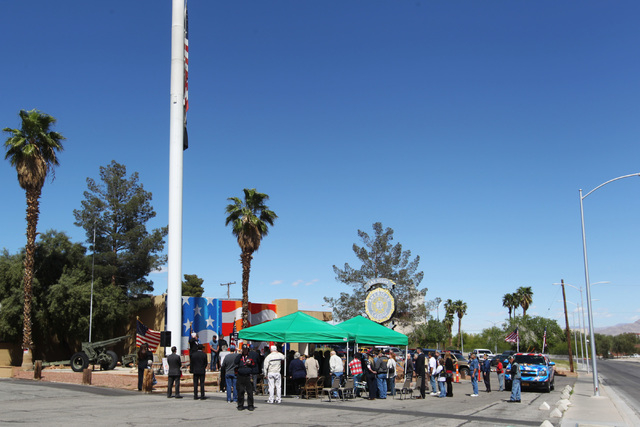 Veterans and supporters gather for a ceremony to thank artist Scott Lobaido for the U.S. flag that he painted on the side of American Legion Post 8 Wednesday, April 8, 2015. (Sam Morris/Las Vegas  ...