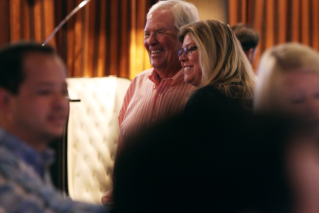 Bill Foley has his photo taken with hockey fan Tracy Fellenstein at an event to promote season ticket sales for a potential NHL franchise Tuesday, March 24, 2015 at Born and Raised bar. (Sam Morri ...