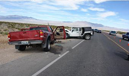 A red Ford Ranger pickup driven by Gary Gray is shown in this photo provided by the Nevada Highway Patrol following a collision with the white Jeep Wrangler on Kyle Canyon Road on Thursday, April  ...