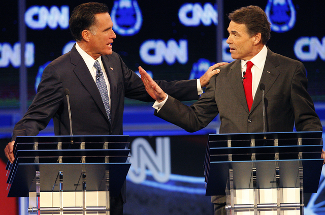 Las Vegas was host to one of the 2012 Republican presidential debates. Former Massachusetts Gov. Mitt Romney, left, and former Texas Gov. Rick Perry work out a difference of opinion during the GOP ...
