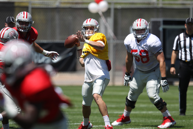 Quarterback Blake Decker rears back to pass while being protected by center Will Kreitler during UNLV football's spring scrimmage Saturday, April 18, 2015. (Sam Morris/Las Vegas Review-Journal) Fo ...