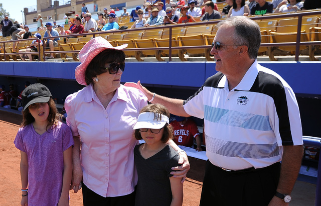Las Vegas 51s president and COO Don Logan,right, greets Lois Tarkanian, center, and grand daughters Ashley, left, Ava before the start of their minor league baseball game against the Fresno Grizzl ...
