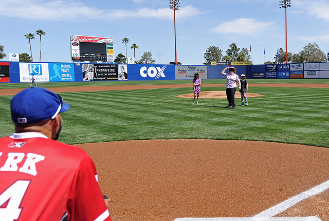 Lois Tarkanian, center, grand daughters Ashley, left, Ava throw out the first pitch before the start of a minor league baseball game between the Fresno Grizzlies and Las Vegas 51s at Cashman Field ...