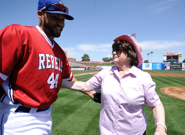 Las Vegas 51s outfielder Cory Vaughn, left, greets Lois Tarkanian after Tarkanian threw out the first pitch before the start of their minor league baseball game against the Fresno Grizzlies at Cas ...