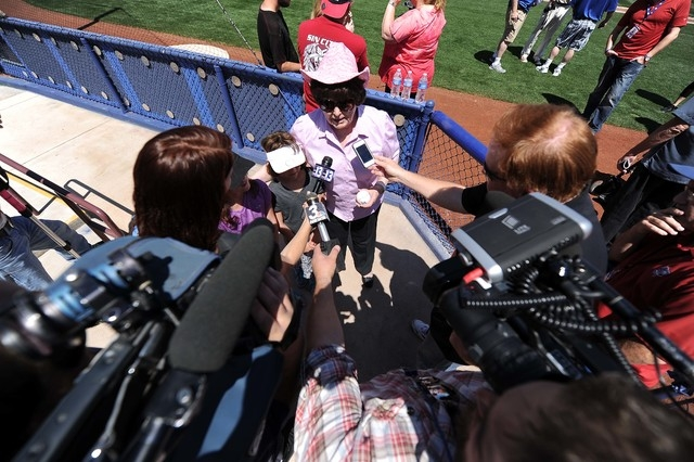 Lois Tarkanian, center, speaks with the media after she threw out the first pitch before the start of a minor league baseball game against the Fresno Grizzlies and Las Vegas 51s at Cashman Field i ...