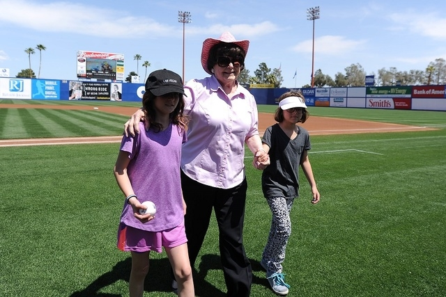 Lois Tarkanian, center, with grand daughters Ashley, left, and Ava walk off the field after she threw out the first pitch before the start of a minor league baseball game against the Fresno Grizzl ...