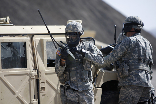 Nevada Army National Guard soldiers participate in a pre-deployment drill at the North Las Vegas Readiness Center in Las Vegas Wednesday, April 22, 2015. About 30 Nevada National Guard soldiers fr ...