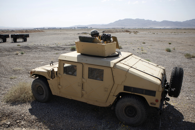 A Nevada Army National Guard soldier keeps watch on top of a HMMWV [common pronunciation Humvee] during a pre-deployment drill at the North Las Vegas Readiness Center in Las Vegas Wednesday, April ...