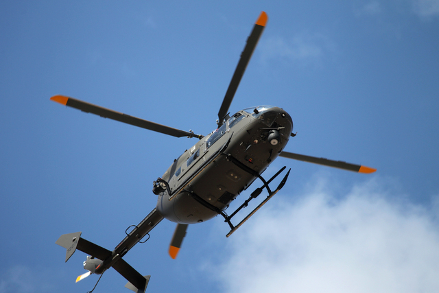 A Nevada Army National Guard UH-72 Lokota helicopter hovers over the ground during a pre-deployment drill at the North Las Vegas Readiness Center, Wednesday, April 22, 2015. About 30 Nevada Nation ...