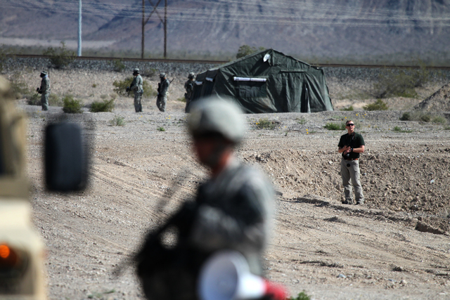 Nevada Army National Guard soldiers participate during a pre-deployment drill at the North Las Vegas Readiness Center in Las Vegas Wednesday, April 22, 2015. About 30 Nevada National Guard soldier ...
