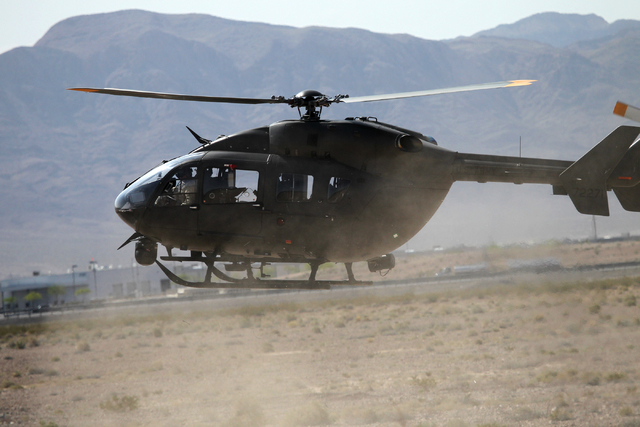 A Nevada Army National Guard UH-72 Lokota helicopter hovers as it comes in for a landing during a pre-deployment drill at the North Las Vegas Readiness Center, Wednesday, April 22, 2015. About 30  ...