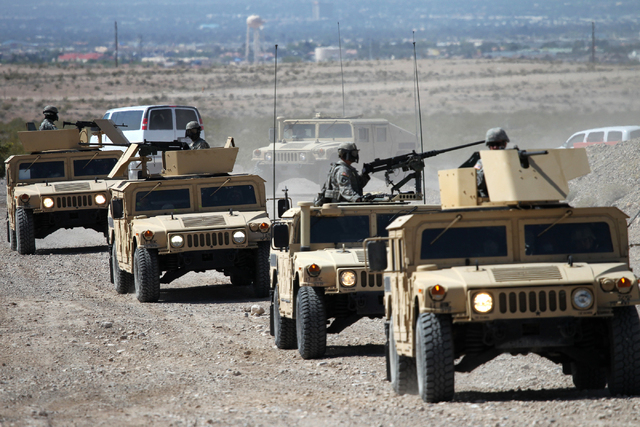 Nevada Army National Guard troops perform in a HMMWV [common pronunciation Humvee] convoy scenario during a pre-deployment drill at the North Las Vegas Readiness Center in Las Vegas Wednesday, Apr ...