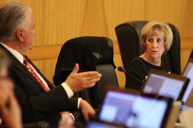 Clark County Commissioners Susan Brager, right, speaks with Steve Sisolak during a discussion on court-appointed guardianships at the Clark County chambers in Las Vegas Tuesday, April 21, 2015. (E ...