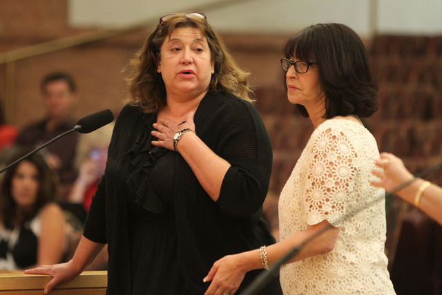 Julie Belshe, right, comforts Elizabeth Indig as she shared her mother's experience with private guardians during a discussion on court-appointed guardianships at the Clark County Commission chamb ...