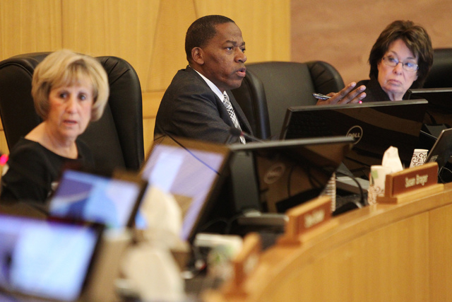 Clark County Commissioner Lawrence Weekly, center, speaks during a discussion on court-appointed guardianships at the Clark County Commission chambers in Las Vegas Tuesday, April 21, 2015. (Erik V ...