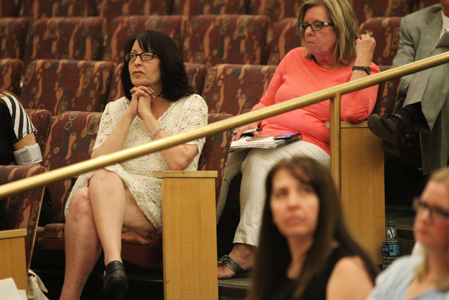 Julie Belshe, left, listens during a discussion on court-appointed guardianships at the Clark County Commission chambers in Las Vegas Tuesday, April 21, 2015. (Erik Verduzco/Las Vegas Review-Journ ...
