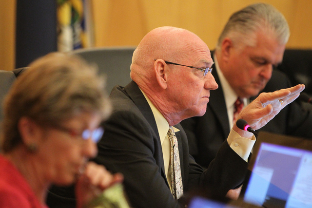 Clark County Commissioners Larry Brown, center, speaks during a discussion on court-appointed guardianships at the Clark County Commission chambers in Las Vegas Tuesday, April 21, 2015. (Erik Verd ...