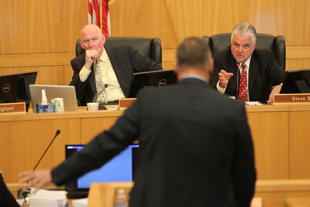 Clark County Commissioners Larry Brown, left, looks on as Steve Sisolak speaks during a discussion on court-appointed guardianships at the Clark County Commission chambers in Las Vegas Tuesday, Ap ...