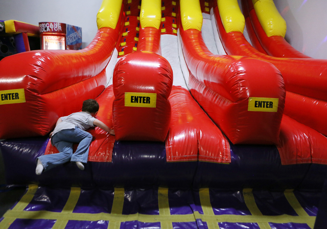 Maddox Long, 4, plays at BounceU Henderson Monday, March 31, 2014. The 1000 Stephanie Place, Suite 14, facility offers a variety of indoor bouncing obstacles as well as creative camps for children ...