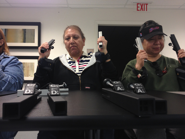 Bell choir members Cindy Pearce, left, and April Lahaina practice playing music with the ARBECY bells at the Blind Center of Nevada, 1001 N. Bruce St., Feb. 3, 2015. Bell choir director, Jerry Sim ...