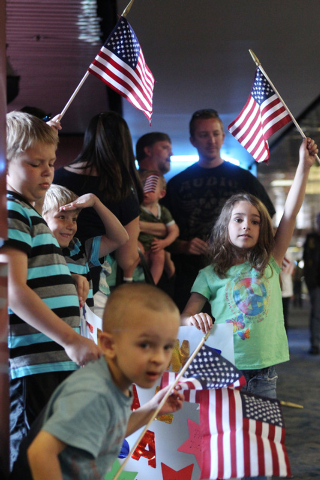 Tyler Ludlow, 9, clockwise from left, his brother Chase, 7, his cousin Raelyn Marty, 5, and Kaiden Cherry, 3, wait for their great grandfather during a flag-waving homecoming event for 28 World Wa ...